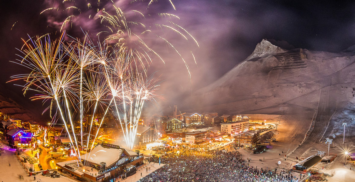 Huge fireworks display and large crowd on the snowfront of Tignes Le Lac for New Year's Eve